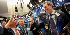 S&P 500 closes at record high amid positive housing data and tech rally